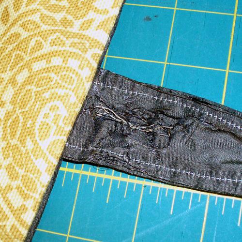 Burnt strap on grey purse
